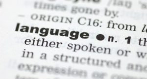 A close up of the word language from a dictionary